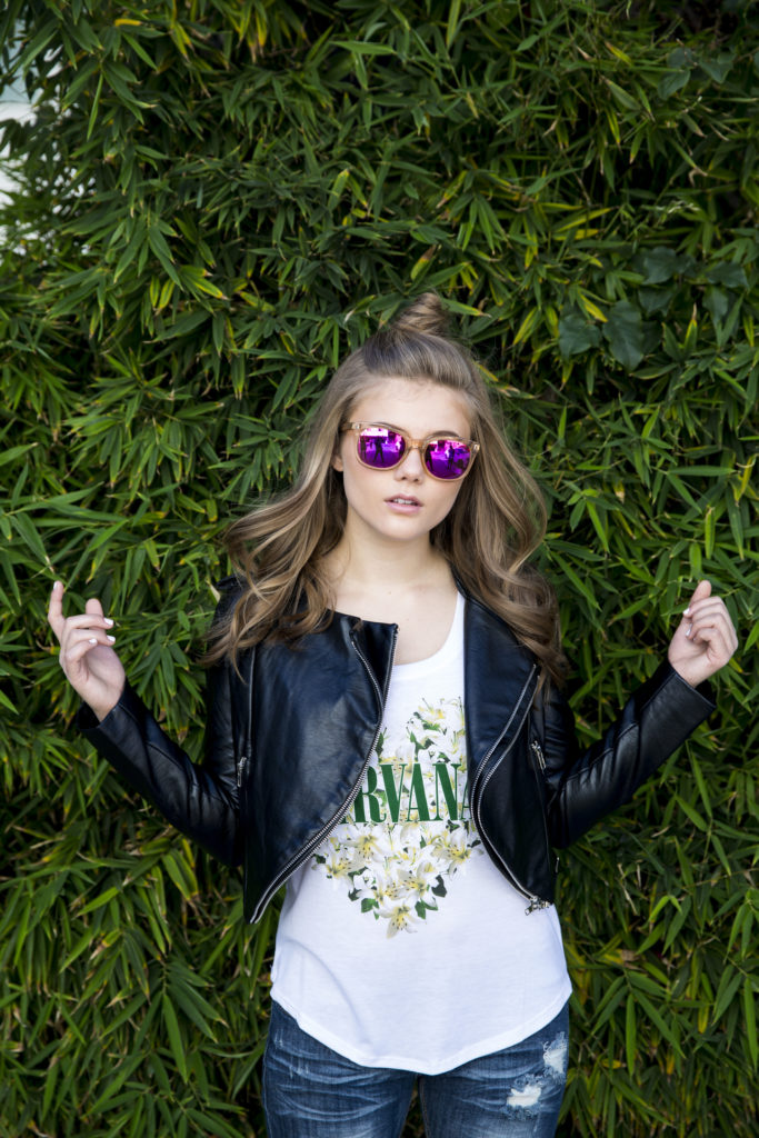 Kerri Medders photo shoot with Leather jacket and Nirvana Shirt with Top Knot Hair Popmania