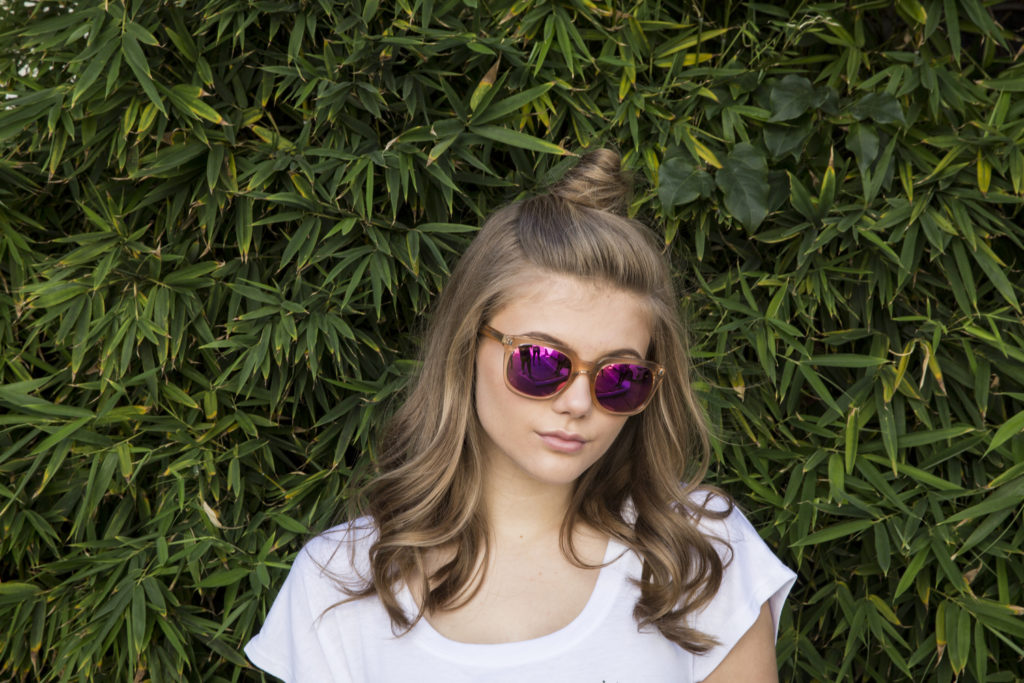 Kerri Medders with Top Knot with pink mirrored glasses Popmania